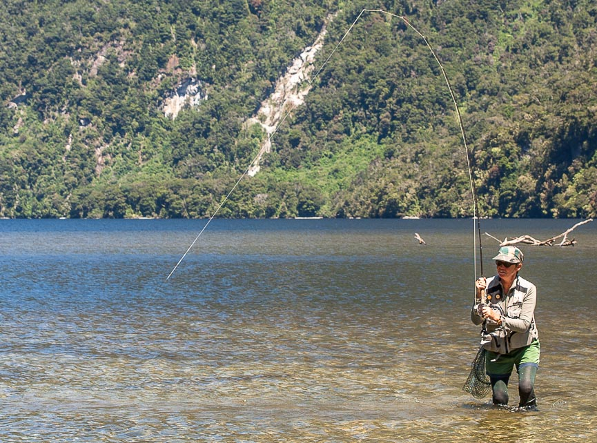 Trout fishing on Lake Te Anau, Fiordland, New Zealand